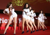 Here is Girls' Generation at the Busan film fest, sans pole --you can decide the lesser of two 'innocents' for yourself.